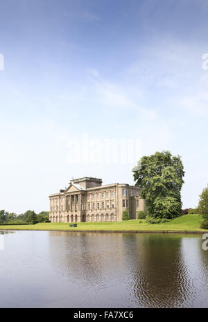 Reflected in its peaceful lake, Lyme Park is famed as one of the locations used in the popular TV series Pride and - Stock Photo