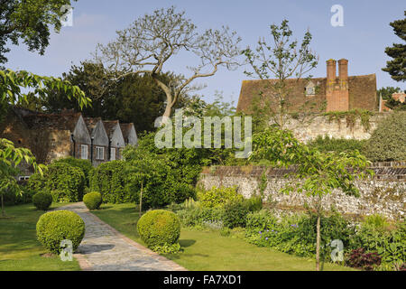 The Cherry Garden at Greys Court, Oxfordshire, in May, with the house seen in the background. - Stock Photo