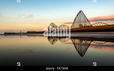 South Beach Blackpool with Pleasure Beach & roller coaster reflecting in pool of water - Stock Photo