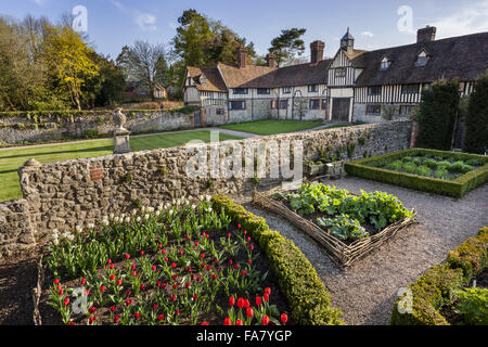 The flower and vegetable garden with the cottages in the background at Ightham Mote, Kent - Stock Photo