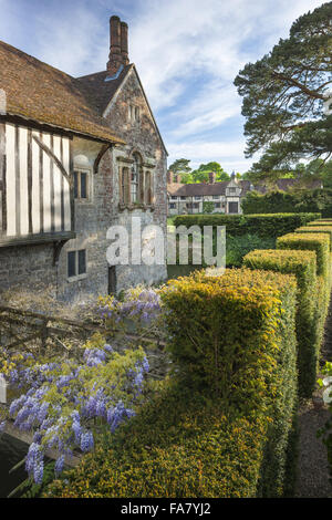 Wisteria and north front with the cottages in the background at Ightham Mote, Kent. - Stock Photo