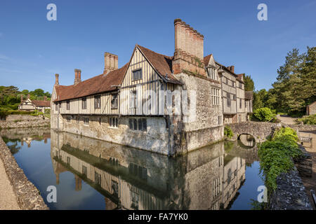 The south east corner with the cottages in the background at Ightham Mote, Kent - Stock Photo