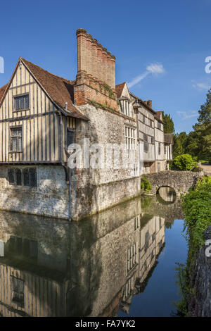 The east corner with the cottages in the background at Ightham Mote, Kent - Stock Photo
