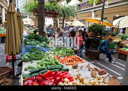 FUNCHAL, PORTUGAL - JUNE 14, 2013: People visit the famous market Mercado dos Lavradores in Funchal, capital city - Stock Photo