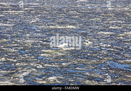 Sea surface with broken ice floes in early spring - Stock Photo