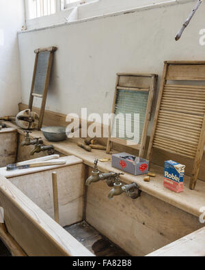 Sinks and washboards in the Laundry at Killerton, Devon. Until it closed in 1940, Killerton Laundry employed three - Stock Photo