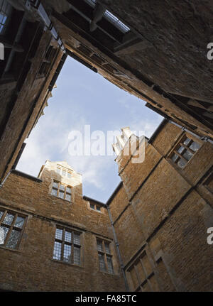 A view looking up towards the roofline from the internal courtyard, or Dairy Court, at Chastleton House, Oxfordshire. - Stock Photo