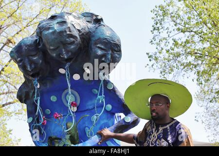 An African American man pulling a float representing slavery in the May Day parade and festival in Minneapolis, - Stock Photo