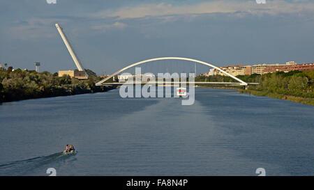 View on the guadalquivir river and the Barqueta bridge - Stock Photo