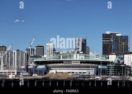 Etihad Stadium on the river bank of the Yarra River in Melbourne, Victoria, Australia, on a sunny summer day.
