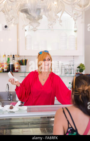 The owner serving ice cream at Le Glacier du Roi, an ice cream shop located in the Panier neighborhood of Marseille, - Stock Photo
