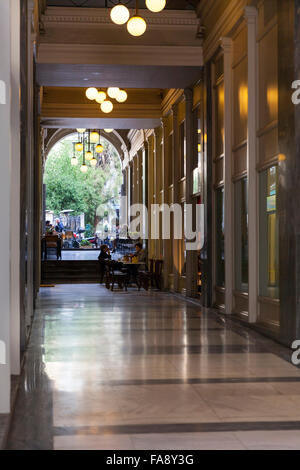 Quiet shopping arcade off Ermou Street in Athens, Greece - Stock Photo