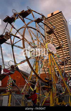 Toronto Christmas Market Ferris Wheel in Distillery District at sundown - Stock Photo