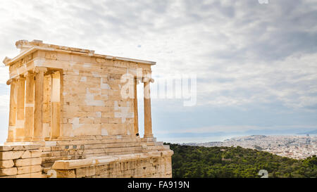 The Temple of Athena Nike at the Acropolis of Athens in Greece, view towards the city and sea in the background - Stock Photo