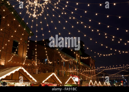 Lights strung over Trinity Street Distillery District for the Toronto Christmas Market - Stock Photo