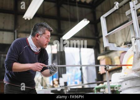 Japanese glass artisan working in the studio - Stock Photo
