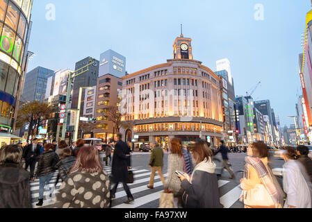 Tokyo, Japan - December 10, 2015: Traffic at  the heart of Ginza District in Tokyo. Wako Building in the background. - Stock Photo