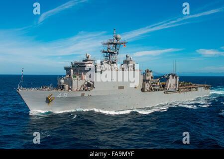 U.S. Navy amphibious dock landing ship USS Harpers Ferry underway in the Pacific Ocean December 10, 2015 off the - Stock Photo