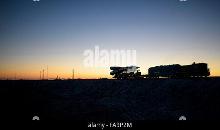The Soyuz TMA-19M spacecraft is rolled out to the launch pad by train at sunrise December 13, 2015 in Baikonur, - Stock Photo
