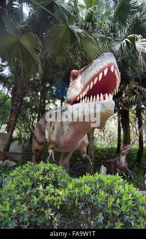 Tyrannosaurus rex - dinosaur in the forest - Stock Photo