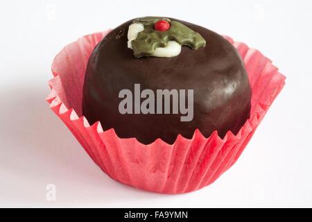 Christmas pudding chocolate truffle cake isolated on white background - Stock Photo