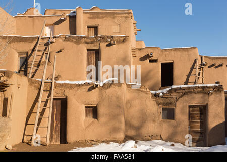 Adobe homes in winter taos new mexico stock photo for Adobe construction pueblo co