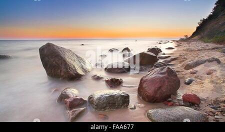 Baltic Sea shore before sunrise, Pomerania, Poland - Stock Photo