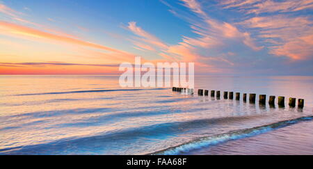 The Baltic beach sea at sunset, Pomerania, Poland - Stock Photo