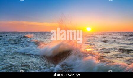Sea waves at sunset time, Baltic Sea, Pomerania, Poland - Stock Photo