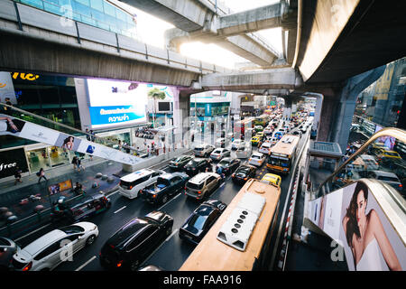 Traffic and skytrain tracks at Siam, in Bangkok, Thailand. - Stock Photo