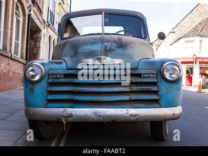 Front View of a Blue 1950 Chevrolet Pickup Truck - Stock Photo