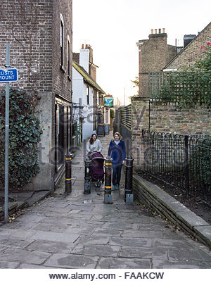 Two women pushing a pram near the famous Dove pub in Hammersmith, London - Stock Photo