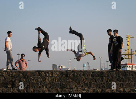 Anzali Port, Iran. 24th Dec, 2015. Iranian teens practice parkour in Anzali Port in Gilan province, northern Iran, - Stock Photo