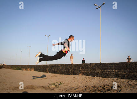 Anzali Port, Iran. 24th Dec, 2015. An Iranian young man practices parkour in Anzali Port in Gilan province, northern - Stock Photo