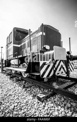 old locomotive abandoned on a siding - Stock Photo