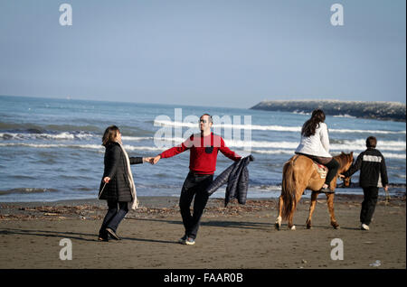 Anzali Port, Iran. 24th Dec, 2015. People enjoy their time on the beach of Anzali Port in Gilan province, northern - Stock Photo