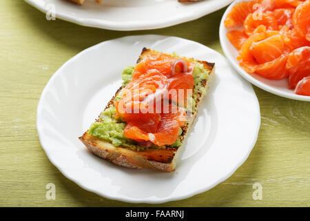 bruschetta with smoked salmon, food closeup - Stock Photo