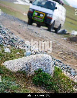 vehicle in a mountain valley on the roads. Journey to Mongolia - Stock Photo