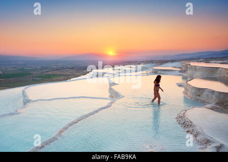 Pamukkale - limestone terraces at sunset, Pamukkale, Turkey - Stock Photo