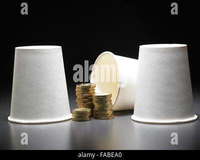 stack of gold coin with three paper cups - Stock Photo