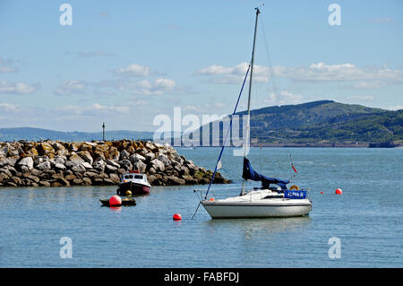 Rhos-on-Sea harbour, the tide is in but the sea is calm - Stock Photo