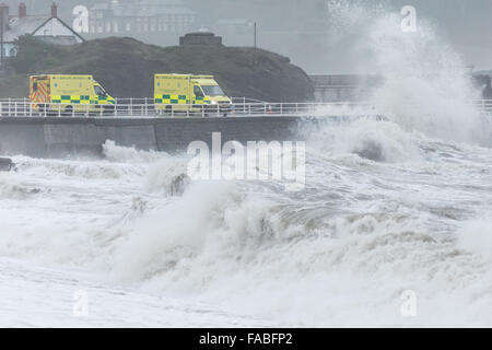 Aberystwyth, Wales, UK. 26th December 2015 Huge waves batter the sea defence walls at Aberystwyth as the bad weather - Stock Photo