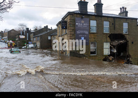 Haworth, UK. 26 December 2105. A wall was partially demolished during floods at the Mill Hey Brew House at the former - Stock Photo