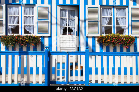 Colorful striped fishermen's houses in blue and white, Costa Nova, Aveiro, Portugal - Stock Photo