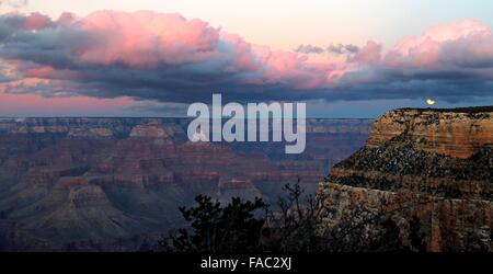 Christmas full moon rising over the South Rim of Grand Canyon December 24, 2015 Grand Canyon Village, Arizona. This - Stock Photo