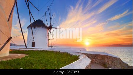 Mykonos sanset landscape with a windmills, Mykonos Island, Greece - Stock Photo