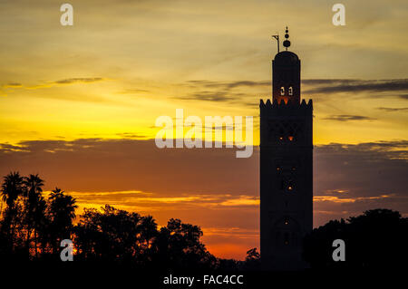 Sunset over  Jemaa el-Fnaa square and Koutoubia Mosque in Marrakesh - Stock Photo