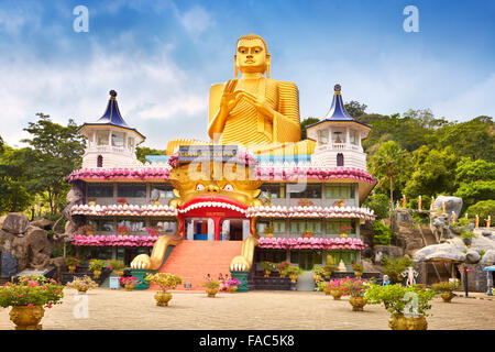 Sri Lanka - Dambulla, Golden Buddha statue over the Buddish Museum, UNESCO World Heritage Site - Stock Photo