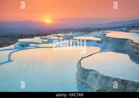 Landscapes at Pamukkale sunset -  terraces of carbonate minerals left by the flowing water, Pamukkale, Turkey - Stock Photo