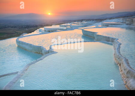 Pamukkale, sunset in the limestone terraces, Turkey - Stock Photo